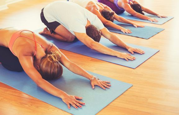 bigstock-Yoga-Class-Group-of-People-Re-99566111_result